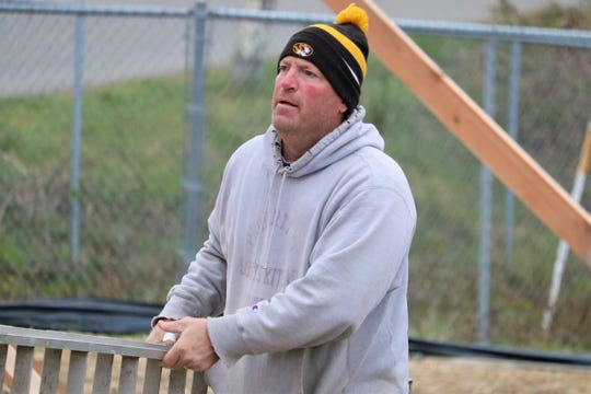 South KItsap High School athletic director Eric Canton works on the school's new hitting facility March 21 in Port Orchard.