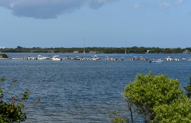 Boaters congregate on a sandbar near a spoil island in the Indian River off SR 528 between Cocoa and Merritt Island Saturday afternoon. The island is a popular gathering place for locals during the summer months.Mandatory Credit: Craig Bailey/FLORIDA TODAY via USA TODAY NETWORK
