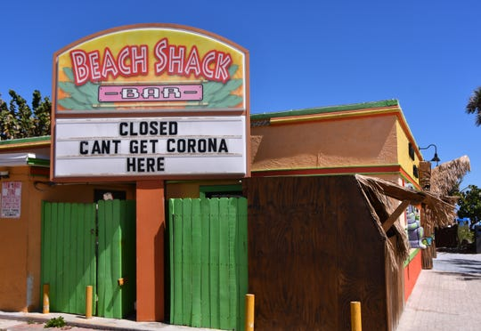 Sign at the Beach Shack. With an alcohol ban on the beaches and limited parking access, Spring Break in Brevard is not what is usually is.