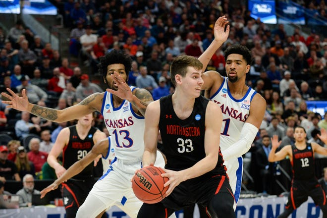 Northeastern Huskies forward Tomas Murphy (33) works around Kansas Jayhawks forward Dedric Lawson (1) and guard K.J. Lawson (13) during the second half in the first round of the 2019 NCAA Tournament at Vivint Smart Home Arena.