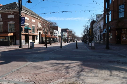 "The Church Street Marketplace was nearly deserted at 3 p.m. on Saturday, March 21, 2020. Vermont's bars and restaurants were ordered closed on March 17, and many retailers have also closed as many people decide to stay home in the face of the new coronavirus outbreak. ""Talk about social distancing!"" said Jeffrey Pascoe, of South Burlington, who took the photograph."