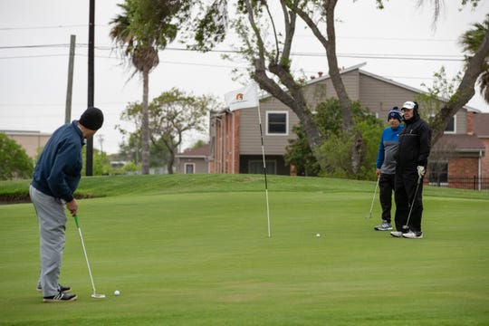 Golfers compete in a tournament at the Gabe Lozano Golf Center on Saturday, March 21, 2020.