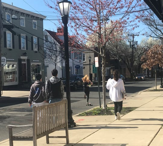 Skateboarders make their way along Tanner Street in Haddonfield Saturday afternoon, hours after Gov. Phil Murphy ordered state residents to stay at home except for essential reasons.