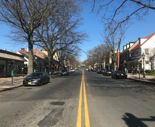 Kings Highway in Haddonfield is largely deserted Saturday afternoon in the wake of a stay-at-home order by Gov. Phil Murphy.