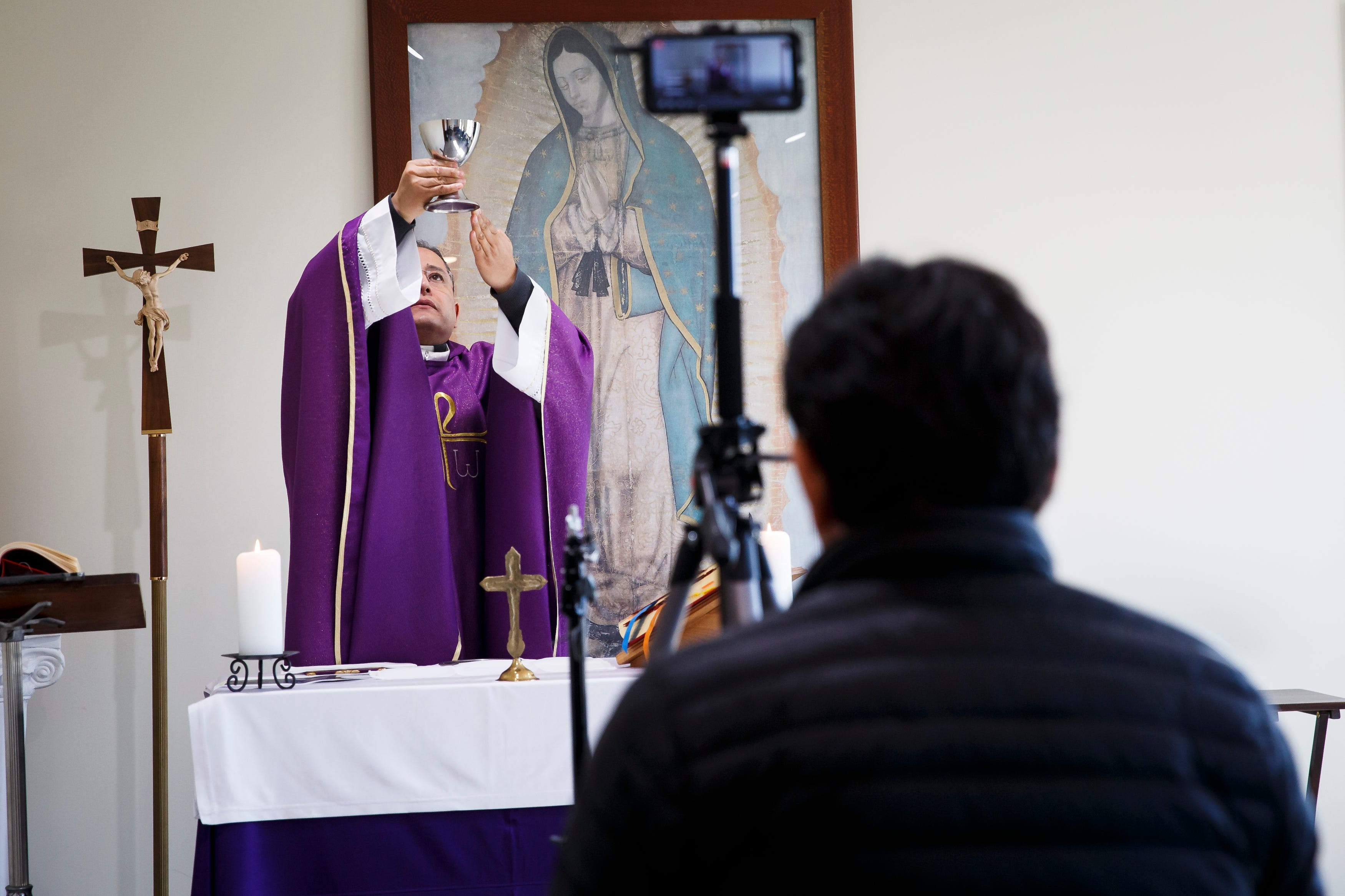 The Rev. Fabian Moncada celebrates Mass in a makeshift chapel as it's streamed live to followers of Our Lady of the Americas Church on Saturday, March 21, 2020, in Des Moines.