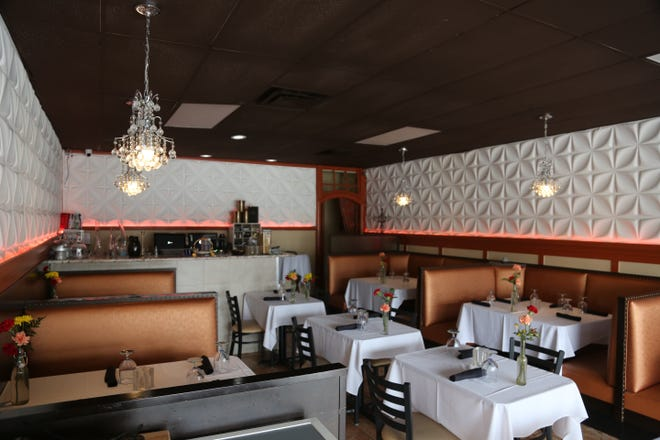The empty dining room at Table No. 2 in northwest Detroit Tuesday, March 17, 2020, a day after Michigan Governor Gretchen Whitmer limited all restaurant operations in the state to delivery and takeout only over novel coronavirus concerns.