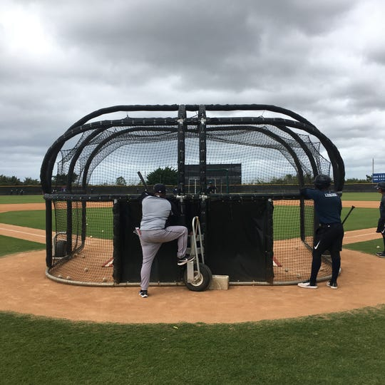 Tigers' Dominican Summer League manager Ramon Zapata watches batting practice with outfielder Iverson Leonardo, at the team's Dominican Republic academy in San Pedro de Macoris, D.R. on Monday, March 9, 2020.