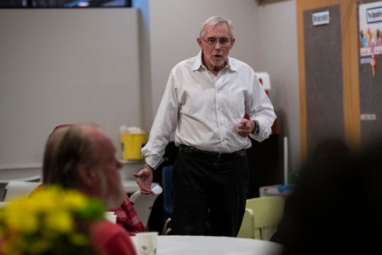 Pastor Peter Moore talks to guests during dinner at Greenfield Presbyterian Church in Berkley, Wednesday, March 18, 2020.