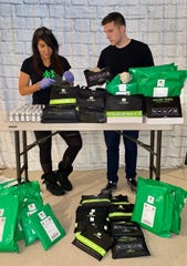 Gina Hoensheid and her son Hunter, 23, put together kits for people who want something to make their airplane rides a little more sanitary.