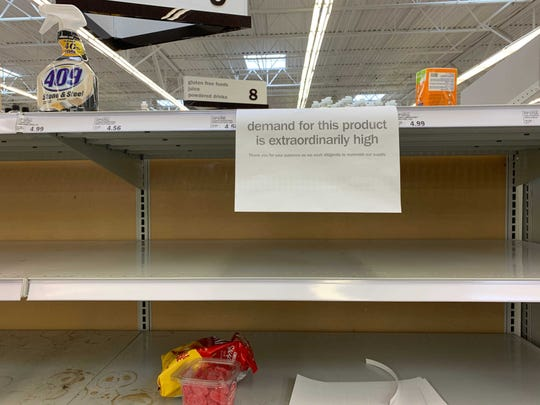 Detroit Meijers store is seen with some empty shelves as shoppers stock up on food and household supplies as people prepare to stay at home during the State's closing of schools and workers are now teleworking from home in an effort to contain the spread of the COVID-19 virus.