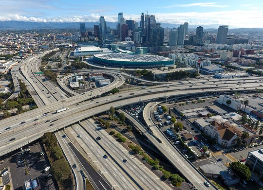 The 10 Freeway and 110 Freeway have less vehicles because of the coronavirus outbreak during midday in downtown Los Angeles, Friday, March 20, 2020.