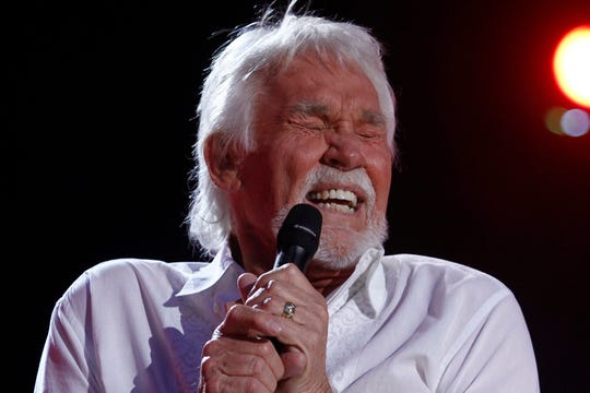 In this June 9, 2012, file photo, Kenny Rogers performs at the 2012 CMA Music Festival in Nashville, Tenn. Actor-singer Rogers, the smooth, Grammy-winning balladeer, died Friday night, March 20, 2020. He was 81.