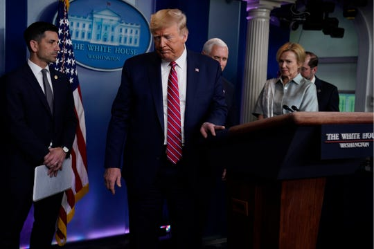 FILE - In this March 20, 2020, file photo President Donald Trump leaves after speaking at a coronavirus task force briefing at the White House in Washington.
