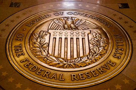 FILE - In this Feb. 5, 2018, file photo, the seal of the Board of Governors of the U.S, Federal Reserve System lies embedded in the floor at the Marriner S. Eccles Federal Reserve Board Building in Washington.