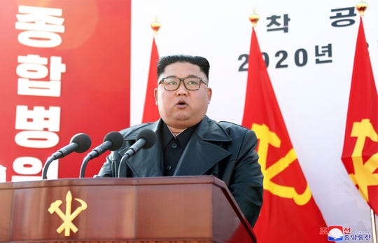 In this Tuesday, March 17, 2020, photo provided on Wednesday, March 18, 2020, by the North Korean government, North Korean leader Kim Jong Un delivers a speech during the ground-breaking ceremony of a general hospital in Pyongyang, North Korea.