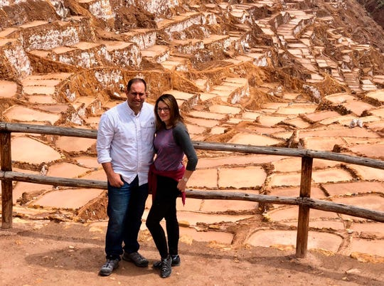 In a photo provided by Linda Scruggs and Mike Rustici, Linda Scruggs and Mike Rustici pose for a photo at salt mines outside Sacred Valley on March 15, 2020, in Peru, just before the Peruvian president announced the country was  going under lockdown.