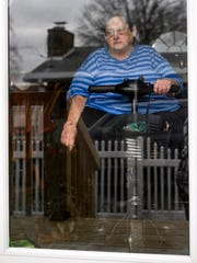 Judy Campbell poses for a portrait while sitting on the scooter she uses to get around her house on Evansville's northside, Friday afternoon, March 20, 2020.