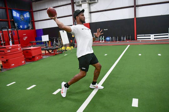 Kelly Bryant throws one of several passes during a workout with Ramon Robinson before the NFL Draft, at D1 Training Facility in Powdersville Friday, March 20, 2020.