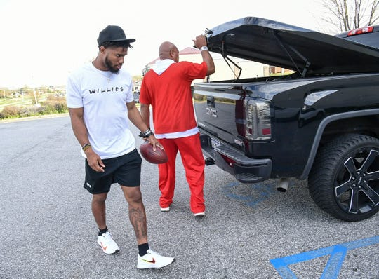 Kelly Bryant arrives at D1 Training Facility with coach Ramon Robinson in Powdersville Friday, March 20, 2020.