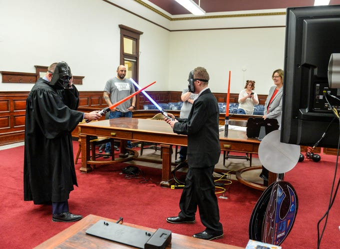 Alexander Reyes, age 12, right, has a lightsaber fight with Judge Greg Pinski during a Star Wars-themed adoption ceremony on Friday, March 20, 2020 in the Cascade County Courthouse. Alex was officially adopted by Philip and Pamela Reyes during Friday's ceremony.