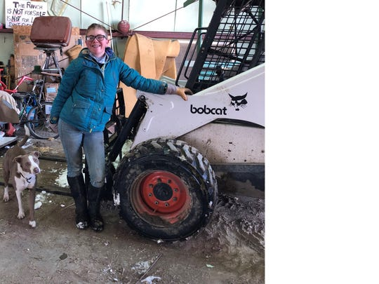 Education doesn't end when classes pause. Abby Hutton used the skid steer to place a bale of hay in the horse manger right before she parked it in the shop with great skill.