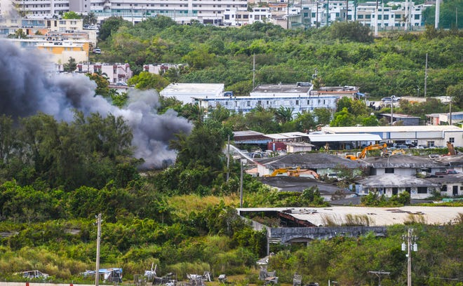 A cloud of black smoke bellows into the sky over Harmon as Guam Fire Department firefighters and other emergency personnel battle a blaze on Saturday, March 21, 2020. The heavy smoke was created by a fire that erupted from a shipping container, tires and other debris at a recycling center, near the old flea market, said Kevin Reilly, GFD spokesman.