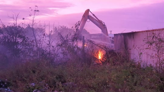 A crane has been called into service by the Guam Fire Department, which is extinguishing a deep-seated fire at a recycling center in Harmon.