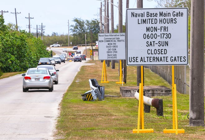 Motorists approach and depart from the back gate of the Naval Base Guam in Sumay on Satruday, March 21, 2020.