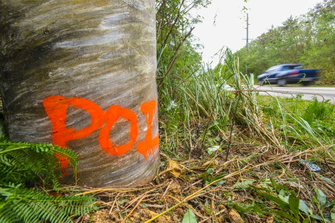 Paint marking on a concrete utility pole, along Route 4A, indicates the point of impact of a fatal crash that occurred early Saturday morning. Police responded to the crash involving the collision of a Kia Rio into the pole, near Rancho Camacho in Talofofo, on March 21, 2020, according to Sgt. Paul Tapao, Guam Police Department spokesman. The male driver of the vehicle was transported to Naval Hospital Guam where he was later pronounced deceased by attending physicians, Tapao added.