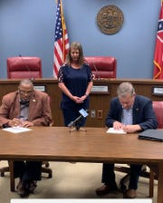 David Hogan, President of the Forrest County Board of Supervisors signs executive order temporarily suspending restaurants and bars located in Forrest County - outside of municipalities - from dine-in service until further notice.