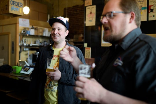 Knox Brew Tours' Zack Roskop leads a Facebook Live brew tour at Pretentious Beer Co. with owner Matthew Cummings in Knoxville, Tennessee on Saturday, March 21, 2020. The coronavirus pandemic has led Roskop to begin live-streaming his tours. People can buy beers in advance and enjoy them virtually with Roskop and brewery owners. During the stream, he will ask for donations to Knox Brew Tours.