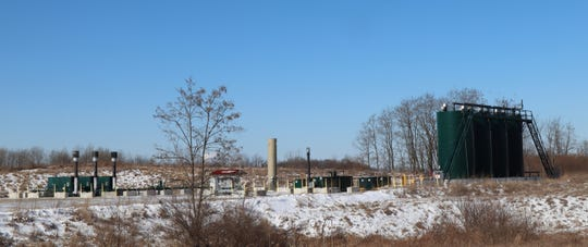Shale gas exploration and production companies in the Appalachian Basin were teetering on a financial cliff, even before the coronavirus pandemic's economic fallout. This is a gas well pad with multiple well heads and tanks just west of Pittsburgh as seen last year.