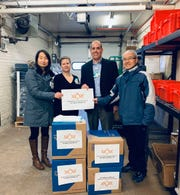 The Greater Lansing Chinese Association donated equipment like masks, gowns and goggles to Sparrow Health System to help health care workers fight the new coronavirus, which is spreading in Michigan. The donation was made Friday, March 20, 2020.