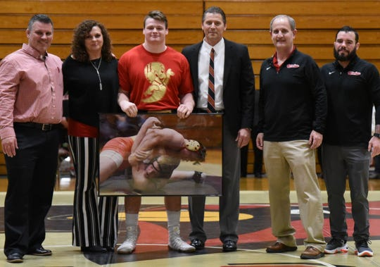 Lexington grad Drew Kasper flanked by his parents, Angie and Brad, along with head coach Brent Rastetter, far left, and assistants Doug Short and Jake Vaughn at Otterbein's Senior Night.