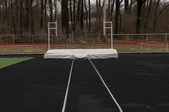 The pole vault pit is undercover last week at Harding Stadium. Spring sports are in the midst of a three-week shutdown as the Ohio High School Athletic Association responds to the coronavirus pandemic.