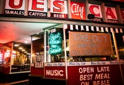 """A handmade sign was posted on a window at Blues City Cafe that reads """"Take out and Uber Eats, call (901) 526-3637"""" on Beale Street in Downtown Memphis, Tenn., on Friday March 20, 2020."""