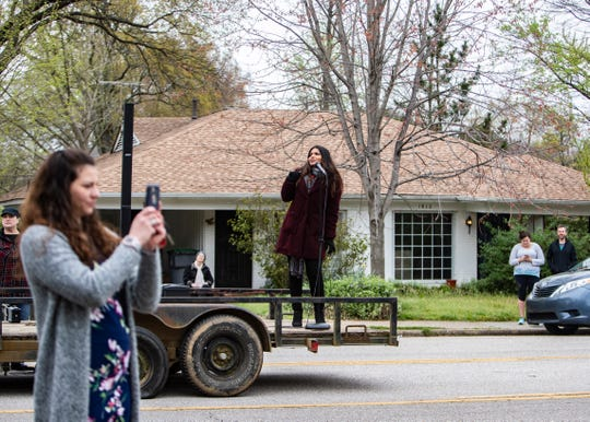 """Mezzo-soprano singer Tahanee Aluwihare performs to a crowd during the Opera Memphis """"Sing to Me"""" concert on Galloway Ave. on Saturday March 21,2020. Opera Memphis wants residents to practice social distancing  while enjoying a live show."""