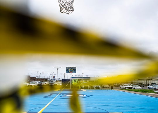 The Precinct basketball courts blocked off with caution tape to encourage social distancing in Memphis, Tenn., on Saturday March 21,2020.