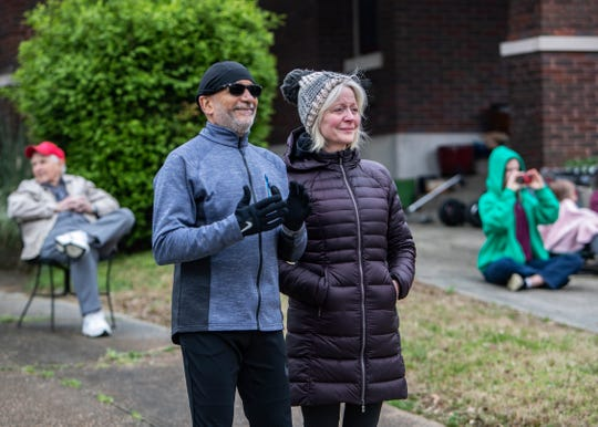 """Edwin Thorpe and Sharon Thorpe watch Opera Memphis singers perform during the """"Sing to Me"""" concert on Galloway Ave. on Saturday March 21,2020. Opera Memphis wants residents  practice  social distancing  while enjoying a live show."""