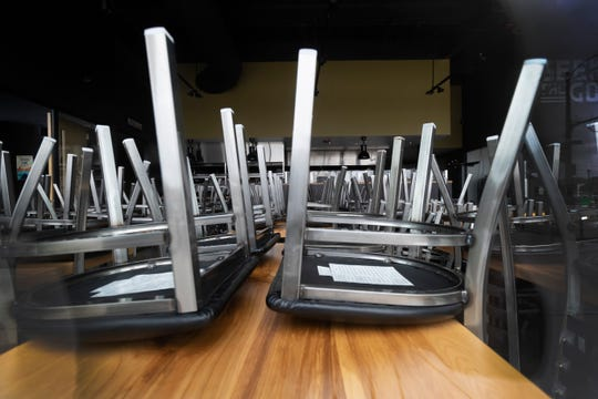 Chairs are stacked on tables at Good City Brewing Friday, March 20, 2020 across from the Fiserv Forum in Milwaukee, Wis. Good City Downtown, the craft brewery's location at 333 W. Juneau Ave., announced on March 13 that it will close until further notice.