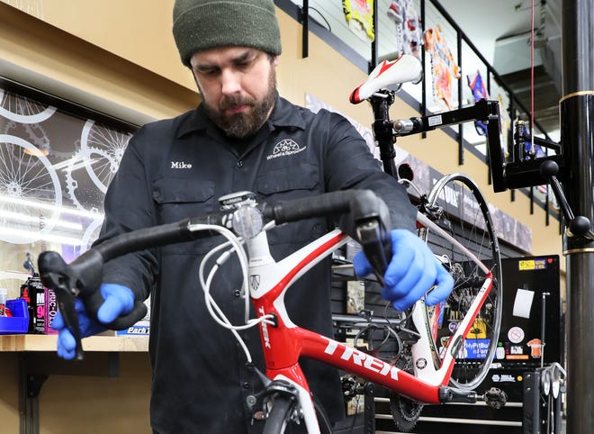 Service manager Mike Teff works on getting a customer's bike ready for the season at Wheel and Sprocket bike shop in Fox Point. The shop have been busy with people buying bikes and getting them repaired or tuned up for the season.
