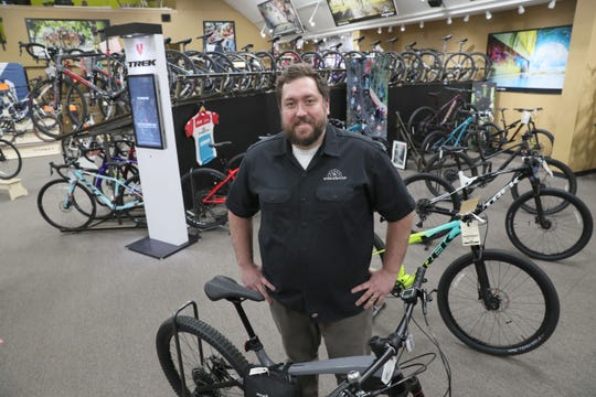 Noel Kegel, president of Wheel and Sprocket bike shop, has noticed an uptick in people coming in — especially young families — who have more time to bike.