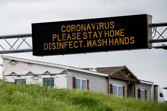A digital sign warns drivers to stay home because of coronavirus on I-85 in Montgomery, Ala., on Saturday, March 21, 2020.