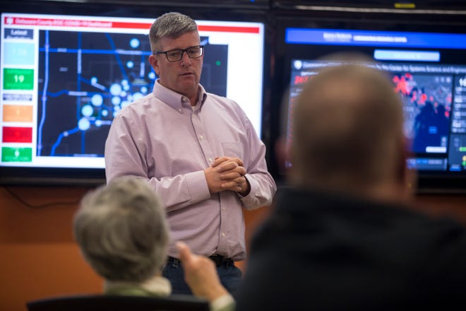 Delaware County EMA Director Jason Rogers addresses questions form elected county officials during an emergency meeting at the Delaware County Emergency Operations Center.