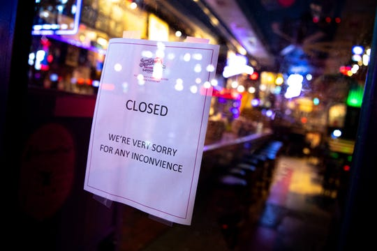 A sign on the door of Tootsie's states their closure as bars remain closed in an effort to slow the spread of Coronavirus in Nashville, Tenn., Friday, March 20, 2020.