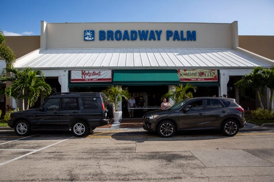 Volunteers hand out meals at Broadway Palm Dinner Theatre in Fort Myers on Saturday, March 21, 2020.