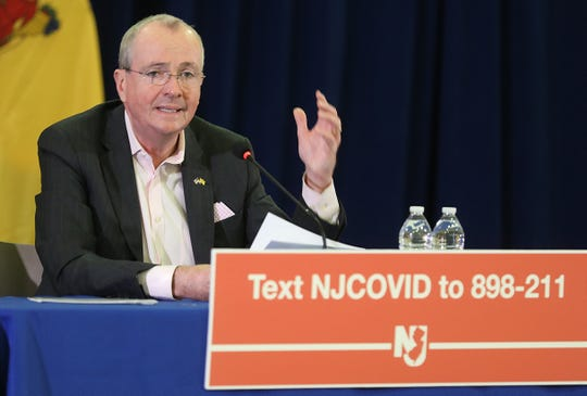 """The daily briefing by Governor Phil Murphy and members of his staff discussing the corona virus at Rutgers University in Newark on March 21, 2020 so as to give more room for """"social distancing"""" to members of the media and his experts being interviewed."""