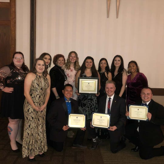 Students from New Mexico State University's School of Hotel, Restaurant and Tourism Management and HRTM faculty member Julie Correa hold awards they won last month during the National Society of Minorities in Hospitality conference in Houston.