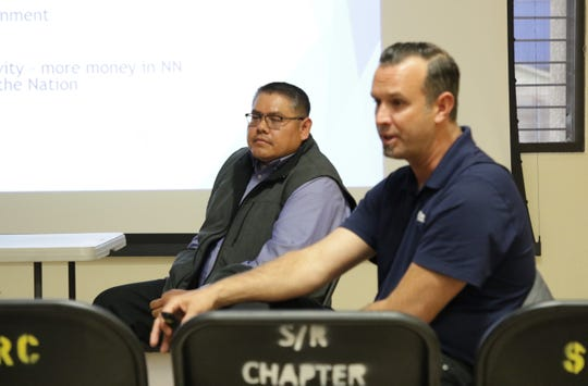 Navajo Cyber Team member Vernon Livingston, left, and Courtney Violette, chief operating officer for Magellan Advisors, listen to comments on March 11 about a broadband strategic plan for the Navajo Nation.