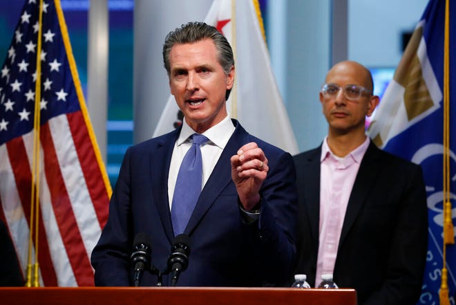 California Gov. Gavin Newsom gives an update on the state's response to the coronavirus at the Governor's Office of Emergency Services in Rancho Cordova, Calif., on Tuesday, March 17.